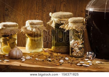 Mouse in larder with stockpiles on old wooden table