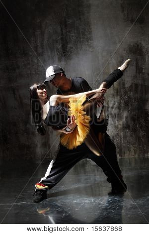 modern style dancer posing on dirty grunge background