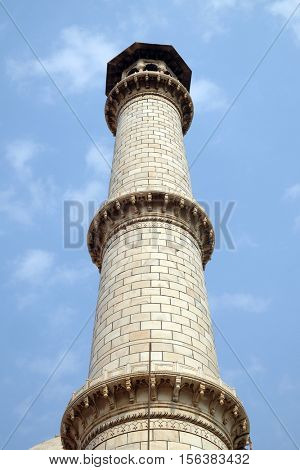 AGRA, INDIA - FEBRUARY 14: Minaret of the Taj Mahal (Crown of Palaces), an ivory-white marble mausoleum on the south bank of the Yamuna river in Agra, Uttar Pradesh, India on February 14, 2016.
