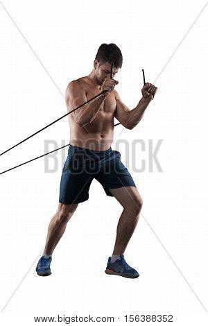 Strong athlete making exercises with wisp isolated on white background