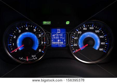 Modern car illuminated dashboard closeup. sport car concept.