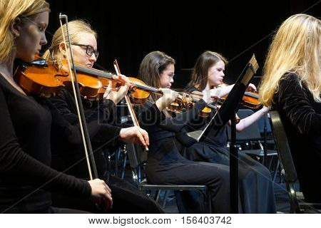 JOLIET, ILLINOIS / UNITED STATES - OCTOBER 30, 2016: The Metropolitan Youth Symphony Orchestra rehearses prior to a concert at Joliet Junior College.