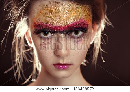 Woman with fashion bright colorful gloss makeup