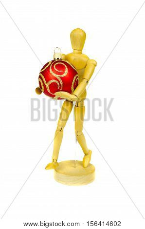 wooden artist manikin holding christmas bauble isolated on white