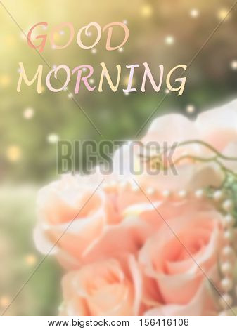 sweet dreamy and de-focused Good morning word on vintage background bouquet of pink roses with flare light