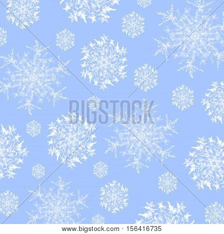 Winter background. Abstract snowflakes pattern white on pastel blue, delicate and dreamy.