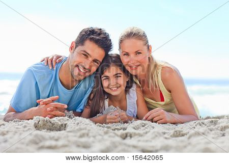 Girl with her parents at the beach