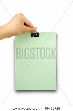 close up of hands holding a paper clip green