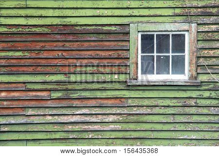old grunge green wooden panel with glass windows