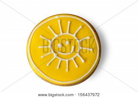 Cookie with a painting. Icing of bright yellow color. Let the sun shine brighter. Charge of good mood.