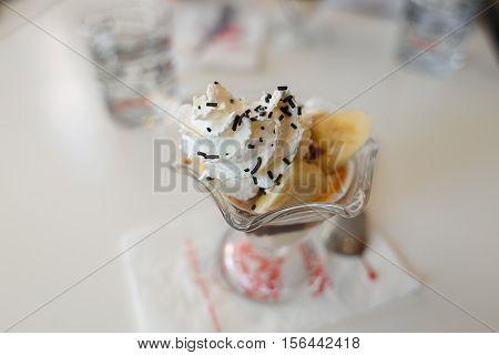 banana split and sundae ice cream in cafe