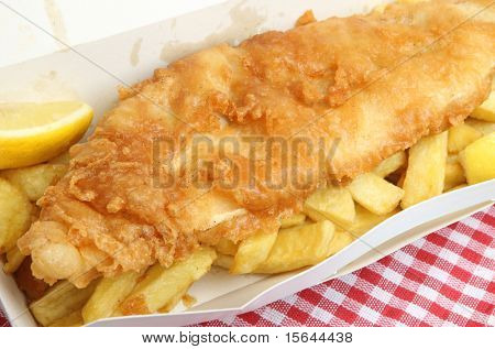 Fried cod & chips in cardboard takeaway carton.