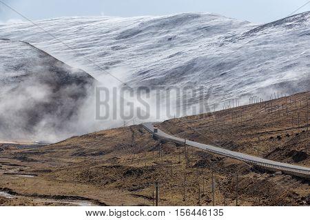 Beautiful winter road in Tibet under snow mountain Sichuan China