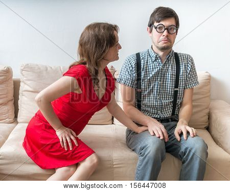 First Date Of A Couple. Young Woman Is Flirting With Shy Man Sit