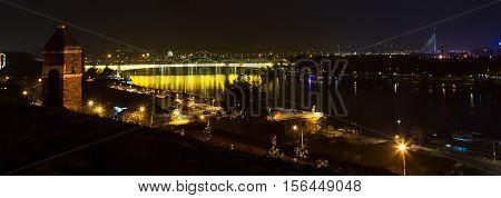Belgrade city panorama, Serbia at the night time. Ada Bridge, buildings and Danube river