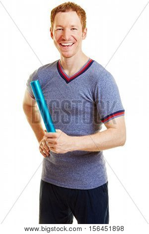 Athlete with a baton ready to run a race and smiling