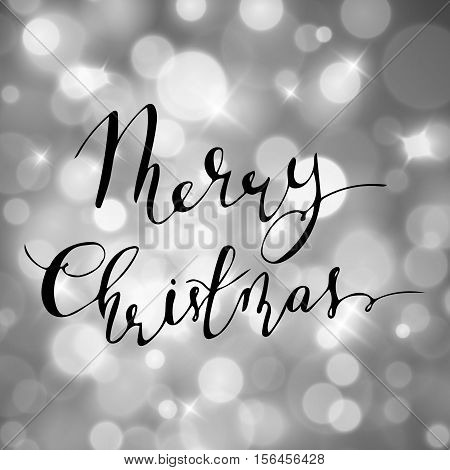 Magical background with night bokeh for holiday silver with handwritten Merry Christmas bouncing letters