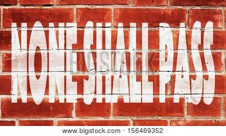 None Shall Pass Written On A Brick Wall.