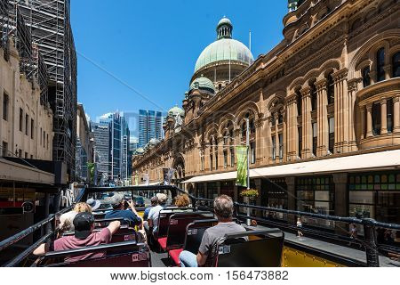 Sydney Australia - November 8 2014: Hop-on Hop-off buses are a great way to visit and explore the sights in Sydney. People can get on and off the bus at designated locations throughout the city to see sights around the city. These double decker buses are