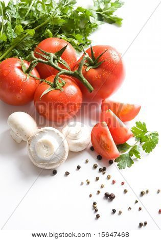 Fresh red tomatoes. Some parsley, champignons and spices. All on white background.
