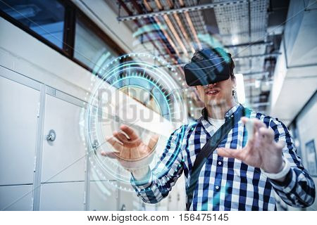 Digital composite of volume knob with graphs against student using virtual reality headset in locker room