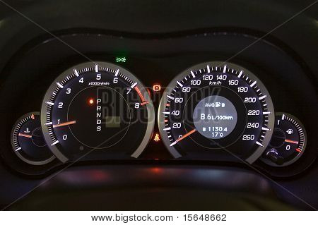 Car instrument panel. Illuminated in the night.
