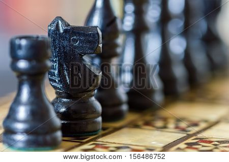 Close Up Of Chess Pieces With Focus On Knight.