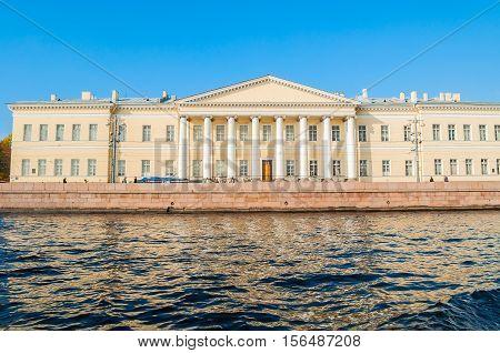 ST PETERSBURG RUSSIA - OCTOBER 3 2016. Building of the St Petersburg Academy of Sciences on Vasilevsky Island at University quay in St Petersburg -facade view. Architecture landmark of St Petersburg