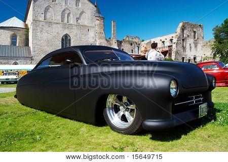 HAAPSALU, ESTONIA - JULY 18: American Beauty Car Show, showing mat black 1949 Mercury Custom, front view on July 18, 2009 in Haapsalu, Estonia
