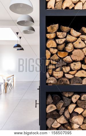 Rack To Store Firewood In White Living Room