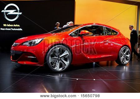 PARIS, FRANCE - SEPTEMBER 30: Paris Motor Show on September 30, 2010 in Paris, showing Opel Astra GTC, front-side view