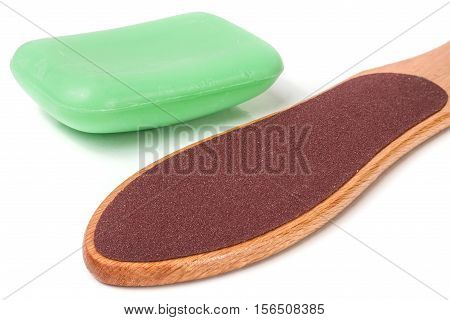 wooden double-sided grater for feet with soap isolated on white background.