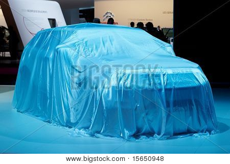 PARIS, FRANCE - SEPTEMBER 30: Paris Motor Show on September 30, 2010, Range Rover Evoque covered before presentation