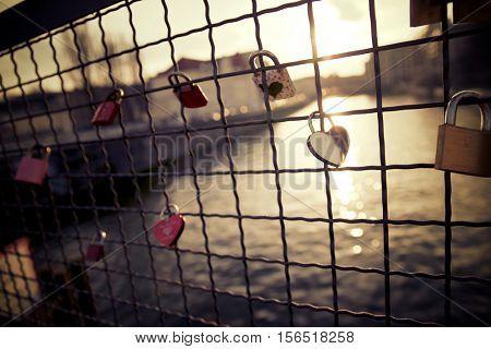 Love padlock on the railing of a bridge, Berlin, Germany.