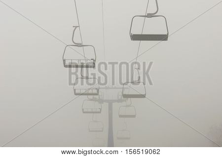 Cabs ropeway leading to heavy fog in mountain