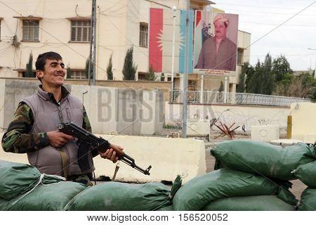 KIRKUK, IRAQ-JANUARY 21: An unidentified Kurdish soldier stands guard on a check point in front of Kurdistan Democratic Party Building on January 21, 2007 in Kirkuk, Iraq.