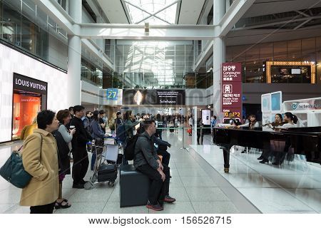 March 8 2016: South Korea Incheon International Airport Korea National live performance in traditional cultural experience center located in the passenger terminal. Concert of classical music for transit passengers. Passengers from different countries are