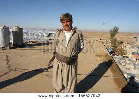 ARBIL,IRAQ-JANUARY 23:Unidentified kurdish soldier stands guard on January 23,2007 in Arbil, Kurdistan, Iraq. They are called peshmerga in Iraq.