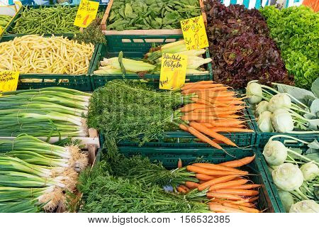 Market stand with fresh vegetables for sale