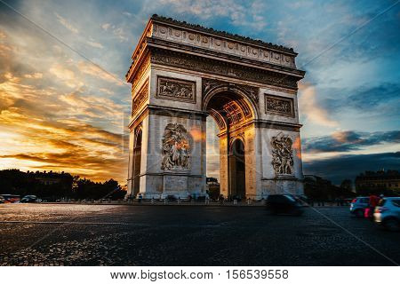 Triumphal arch. Paris. France. View of Place Charles de Gaulle. Famous touristic architecture landmark in summer night. Napoleon victory monument. Symbol of glory.