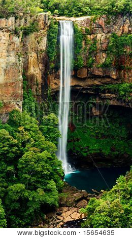 Beautiful Waterfall falls into a turquoise pond