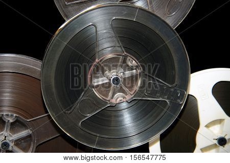 Old rare music reel to tape recorder. Vintage bobine with the music. Nineteenth - twentieth century - most popular medium of recorded music. Historical analog media sound information for gramophones.