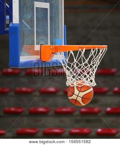 Basketball In The Basket During The Game In The Sports Hall