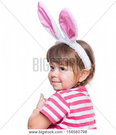 Happy little girl with pink rabbit ears. Portrait of cute caucasian baby wearing bunny ears. Funny preschool child, isolated on white background. Healthy carefree kid - Easter holidays concepts.