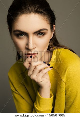 Beautiful fashion model portrait with wet hair in studio