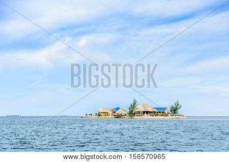 Placencia, Belize - August 28 2016: Houses & palapas on tiny tropical island near Placencia in Belize, Central America