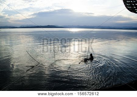 The Fisher man Against the fish in the water