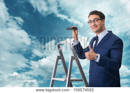 Businessman with binoculars on the stairs ladder