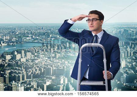 Businessman climbing ladder in business concept