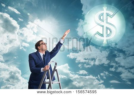 Businessman reaching out to dollars